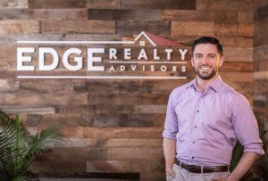 leasing housing - EDGE Realty Matt Gorman standing before EDGE masthead